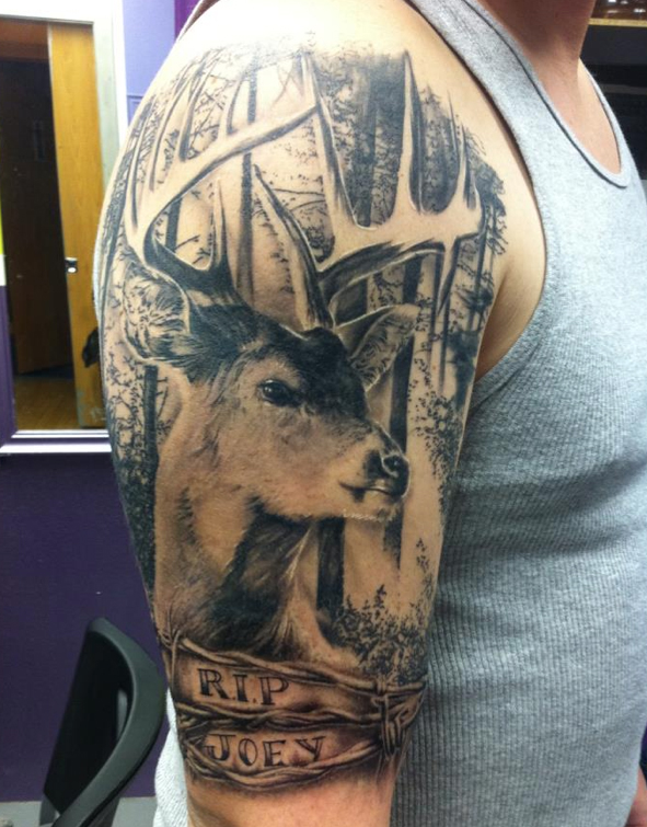 Realistic deer and trees tattoo