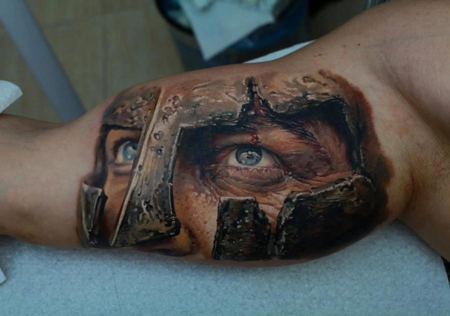 Realistic gladiator tattoo on arm