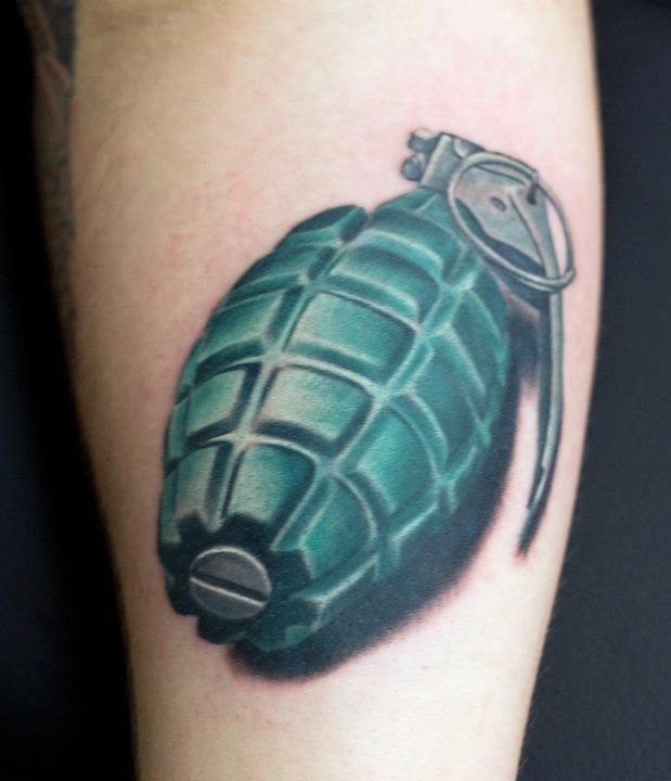 Realistic grenade arm tattoo