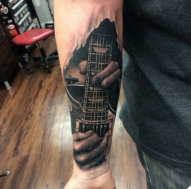 Realistic guitar tattoo by Kyle Cotterman