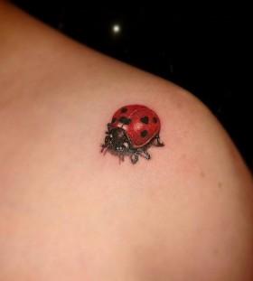 Realistic ladybug shoulder tattoo