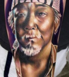 Realistic man tattoo by Kyle Cotterman