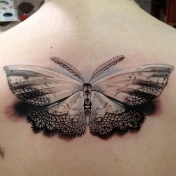 Realistic moth back tattoo