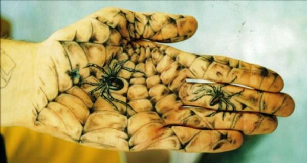 Realistic palm spider web tattoo
