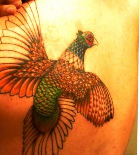 Realistic pheasant tattoo