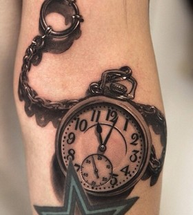 Realistic pocket watch tattoo
