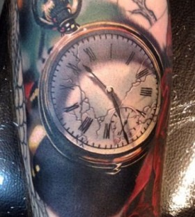 Realistic pocket watch tattoo by Phil Garcia