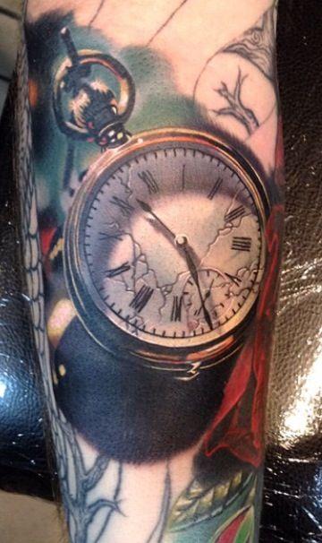 Realistic pocket watch tattoo by Phil Garcia