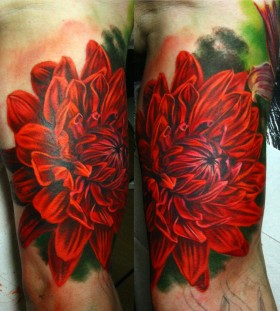 Realistic red dahlia tattoo