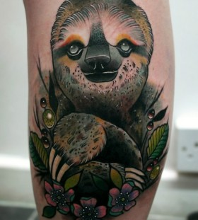Realistic sloth and flowers tattoo