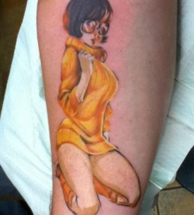 Realistic velma arm tattoo