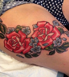 Red roses leg tattoo by Clare Hampshire