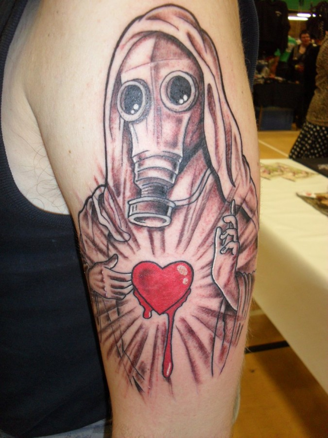 Religious gas mask and heart tattoo