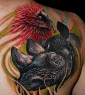 Rhino and bird back tattoo