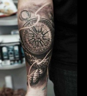 Rope and compass arm tattoo