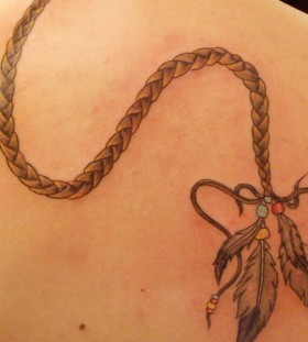 Rope and feathers back tattoo