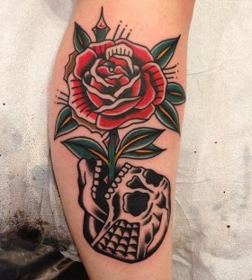 Rose growing from skull tattoo by Nick Oaks