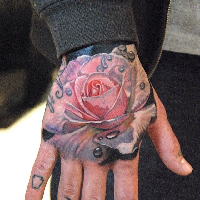 Rose hand tattoo by Phil Garcia