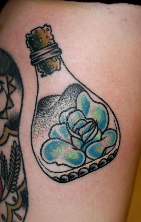Rose in a bottle tattoo
