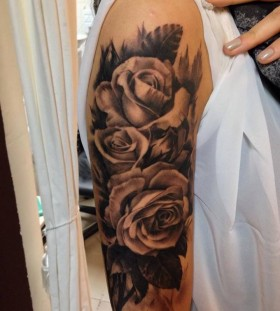 Roses arm tattoo by Razvan Popescu