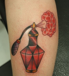 Ruby red perfume bottle tattoo