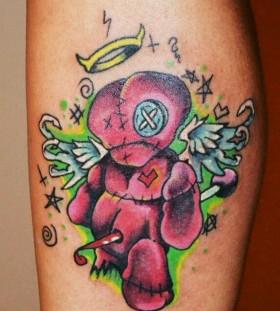 Sad voodoo doll tattoo
