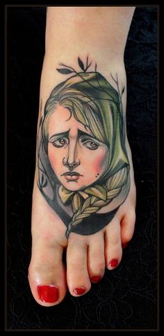 Sad woman foot tattoo