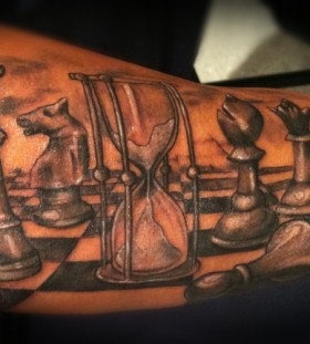 Sand clock and chess tattoo