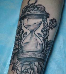 Sand clock and rose tattoo