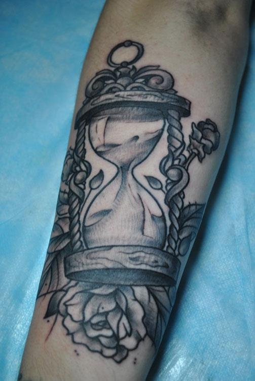 Sand clock and rose tattoo