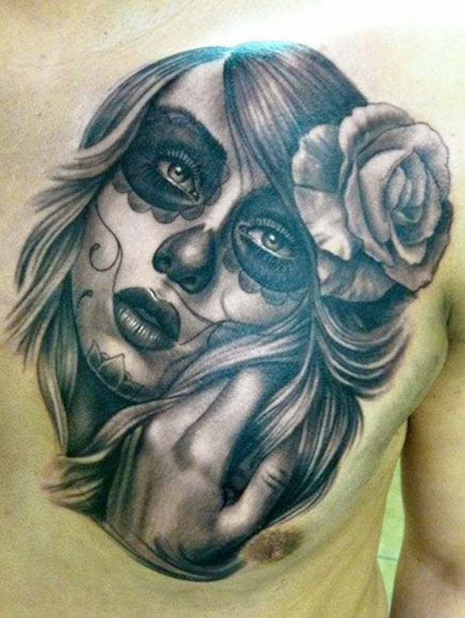 Santa muerte girl with rose in hair tattoo on chest