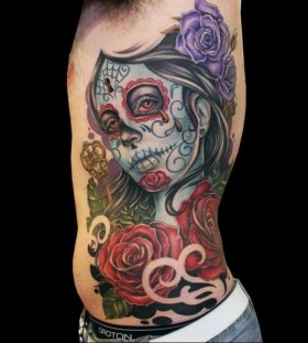Santa muerte tattoo on side