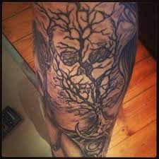 Scary dead tree tattoo