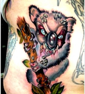 Scary koala bear tattoo
