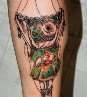 Scary puppet leg tattoo
