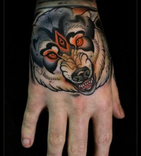 Scary wolf hand tattoo