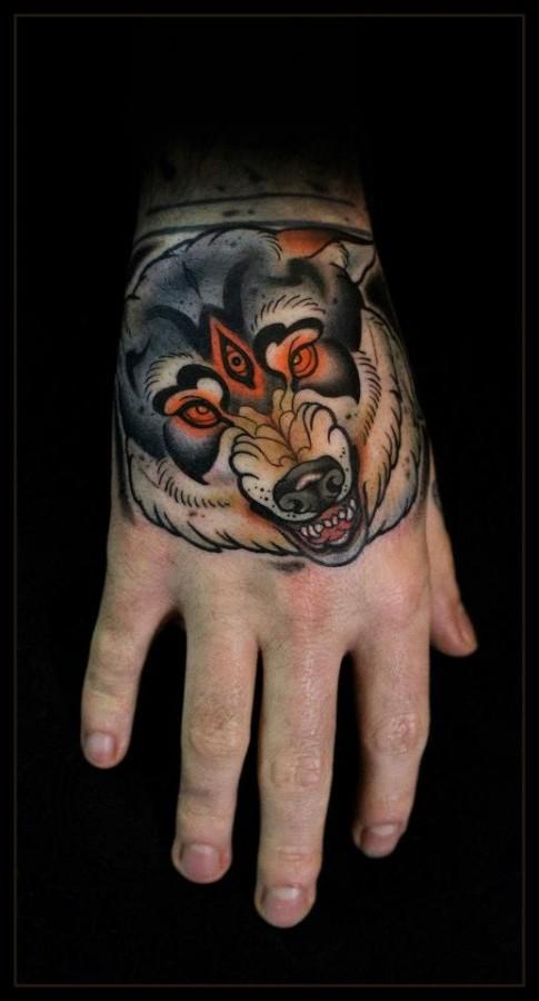 Scary wolf hand tattoo