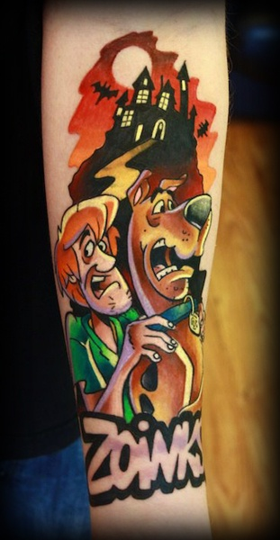 Scooby and shaggy arm tattoo