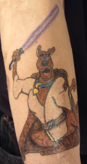 Scooby with a lightsaber tattoo
