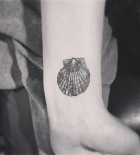 Sea shell arm tattoo