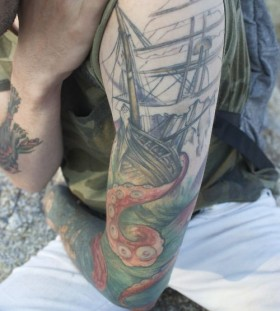 Ship and octopus tattoo by Jessica Brennan