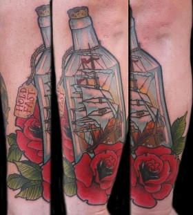 Ship in a bottle and rose tattoo