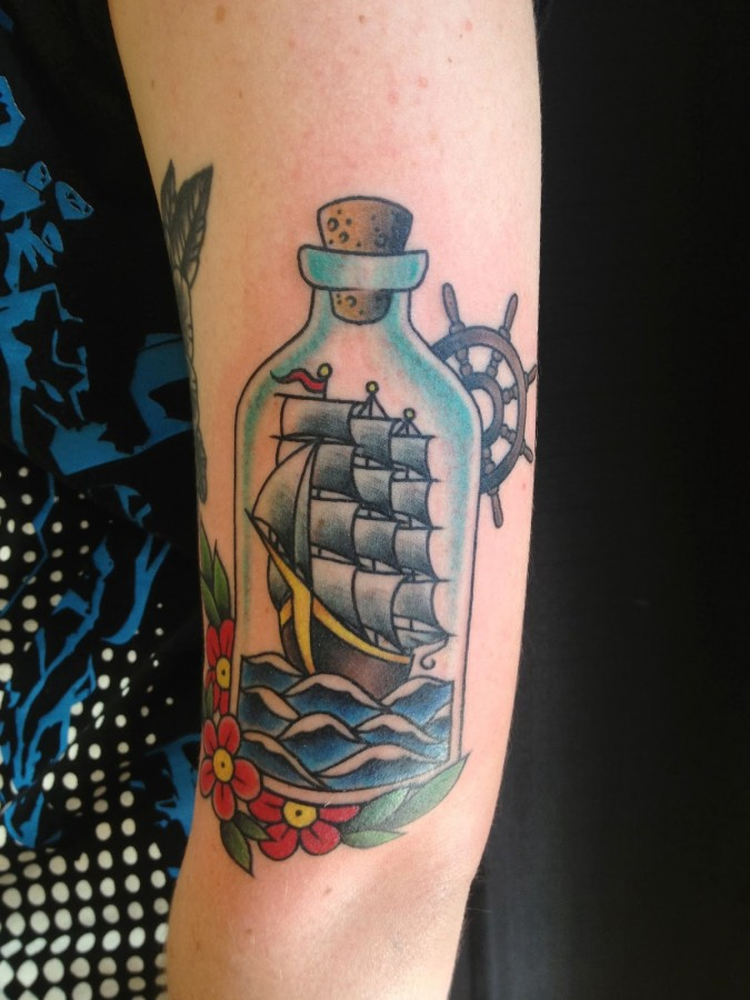 Ship in a bottle arm tattoo