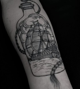 Ship in a bottle tattoo by Thomas Cardiff