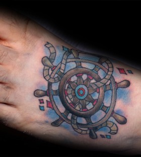 Ship's wheel foot tattoo
