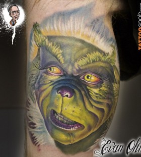 Simle looking grinch christmas tattoo