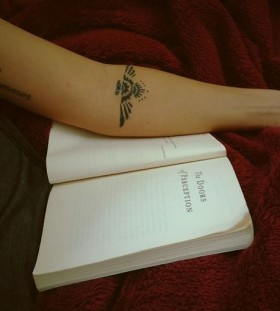 Simple book and tribal bird tattoo