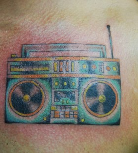Simple boombox chest tattoo