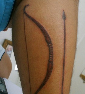 Simple bow and arrow leg tattoo