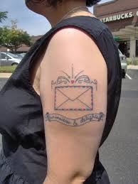 Simple envelope arm tattoo